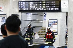 Rescue workers are seen at Odawara station after a Japanese Shinkansen bullet train made an emergency stop on June 9, 2018.
