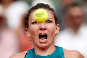 Romania's Simona Halep in action during the final against Sloane Stephens of the US.