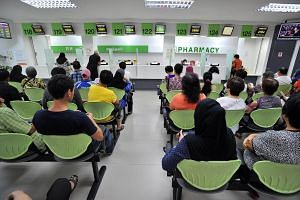 File photo showing patients waiting to pick up medicine at a pharmacy in Tampines Polyclinic.