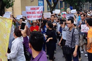 Protesters holding a banner during a demonstration against a draft law on the Special Economic Zone in Hanoi, Vietnam, on June 10, 2018.