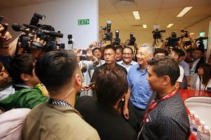 Prime Minister Lee Hsien Loong visiting the international media centre, ahead of the Trump-Kim Summit, on June 10, 2018.