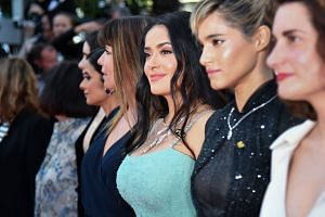 Salma Hayek (centre) taking part in a protest over the lack of female filmmakers honoured at the Cannes Film Festival.
