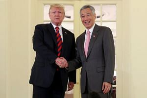 The American delegation, led by US President Donald Trump, having lunch with Singapore's leaders, led by Prime Minister Lee Hsien Loong, at the Istana, on June 11, 2018.