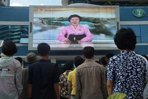 North Korean star presenter Ri Chun Hee, 75, during a seven-minute news bulletin detailing Mr Kim's planned summit with US President Donald Trump on Tuesday.