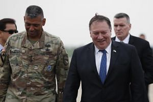 US Secretary of State Mike Pompeo (right), with General Vincent K. Brooks, commander of the US Forces Korea, as he arrives at US Osan Air Base in Pyeongtaek, South Korea, on June 13, 2018.