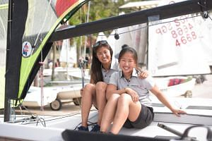 Sailors Kimberly Lim (right), 21, and Cecilia Low, 27.