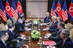 US President Donald Trump listens to North Korean leader Kim Jong Un during the expanded bilateral meeting as part of the historic summit at the Capella Hotel on Sentosa Island.