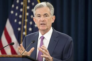 US Federal Reserve Board Chairman Jerome Powell holds a news conference after a Federal Open Market Committee meeting, in Washington, DC, on June 13, 2018.