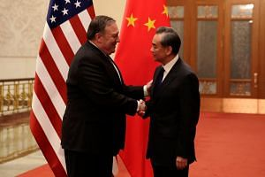 US Secretary of State Mike Pompeo and Chinese Foreign Minister Wang Yi prior to their meeting at the Great Hall of the People in Beijing on June 14, 2018.
