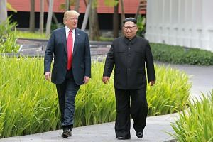 US President Donald Trump (left) and North Korean leader Kim Jong Un at the Capella Singapore hotel on Sentosa island in Singapore, on June 12, 2018.