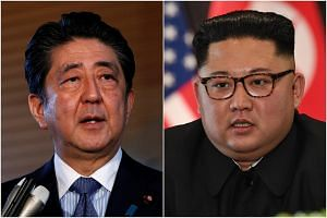 If Japanese Prime Minister Shinzo Abe's (left) visit to Pyongyang proves difficult, Japan is eyeing another scenario for him to meet North Korean leader Kim Jong Un on the sidelines of the Eastern Economic Forum.
