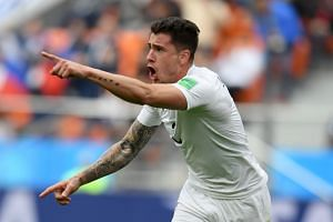 Uruguay's defender Jose Gimenez celebrates scoring the opening goal during the Russia 2018 World Cup Group