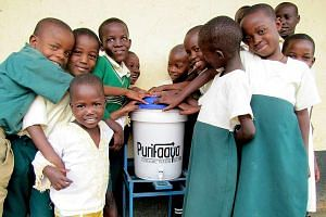 Pupils at one school in Kampala, Uganda, are excited that they have access to safe drinking water. In Uganda, water-borne diseases remain a leading cause of death for children under the age of five.
