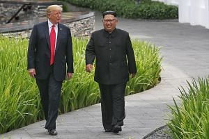 President Donald Trump and North Korean leader Kim Jong Un strolling through the grounds of the Capella Singapore after their working lunch. Mr Kim's image has changed since he came out to the world. The positive vibe was keenly felt during the summi