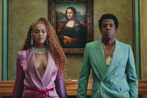 The joint album marries the styles of Jay Z and Beyonce, with songs driven by warm, sultry soul but with a hip-hop delivery.