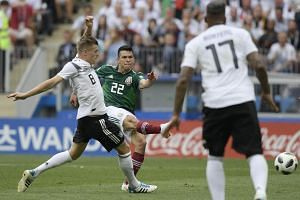 Mexico's forward Hirving Lozano shoots and scores the opening goal in the match against Germany at the Luzhniki Stadium in Moscow, on June 17, 2018.
