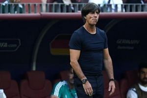 Germany's coach Joachim Low looks on during the Russia 2018 World Cup Group F football match between Germany and Mexico at the Luzhniki Stadium in Moscow on June 17, 2018.