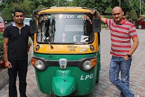 Jugnoo co-founders Chinmay Agarwal (left) and Samar Singla with an auto-rickshaw outside their office in Chandigarh. Its Indian business is built on hailing auto-rickshaws instead of offering cab rides.