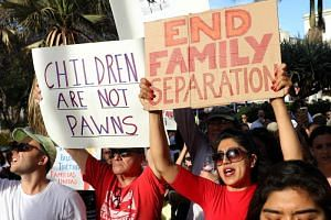 Protesters denounce US President Donald Trump's administration's policy of separating detained immigrant children from their parents during a rally and march in Los Angeles, California, US, on June 14, 2018.