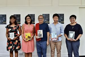 Ethos Books' associate publisher Ng Kah Gay (centre) with Singapore Literature Prize nominees (from left) Euginia Tan, Charmaine Chan, Theophilus Kwek and Charmaine Leung. Epigram Books founder Edmund Wee (centre) with authors (from left) Jennani Dur