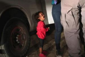 The viral photo of a toddler crying as her mother was detained at the border.
