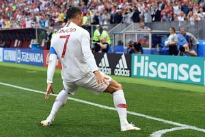 Cristiano Ronaldo celebrates scoring the opening goal during the Fifa World Cup 2018 group B football match between Portugal and Morocco.