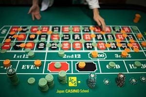 A student practicing the game of roulette at a casino school in Tokyo on June 6, 2018.