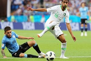 Lucas Torreira (left) of Uruguay in action against Hussain Al Mogahwi of Saudi Arabia during the Fifa World Cup 2018 group A preliminary round soccer match between Uruguay and Saudi Arabia in Rostov-On-Don, Russia, on June 20, 2018.