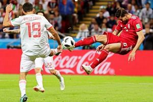 Diego Costa (left) of Spain in action against Saeid Ezatolahi of Iran during the Fifa World Cup 2018 group B preliminary round soccer match between Iran and Spain in Kazan, Russia, on June 20, 2018.