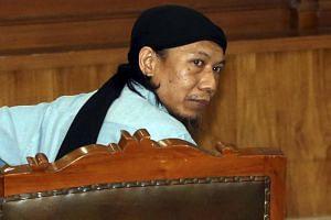 Indonesian terrorist suspect Aman Abdurrahman looks on during his trial in Jakarta, on June 22, 2018.