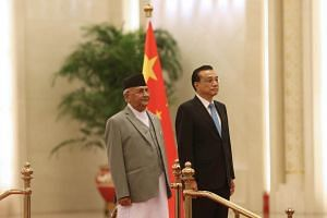 Nepalese Prime Minister Khadga Prasad Sharma Oli (left) and Chinese Premier Li Keqiang attend a welcoming ceremony at the Great Hall of the People in Beijing, on June 21, 2018.