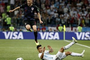 Ivan Rakitic (left) of Croatia and Maximiliano Meza of Argentina in action during the FIFA World Cup 2018 group D preliminary round soccer match between Argentina and Croatia in Nizhny Novgorod, Russia, on June 21, 2018.