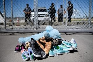 Shoes and toys left at the Tornillo port of entry in Texas where minors crossing the border from Mexico into the US without proper papers have been housed after being separated from adults. The writer says that family separation is a sincere act by p