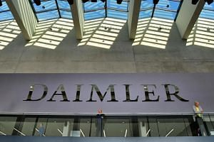 Shareholders wait for the start of German luxury car manufacturer Daimler's annual general meeting in Berlin on April 5, 2018.