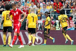 Belgium's Michy Batshuayi celebrates scoring their fifth goal during their match against Tunisia, on June 23, 2018.
