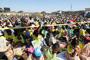 People attend a campaign rally addressed by President Emmerson Mnangagwa (not pictured), at White City Stadium in Bulawayo, Zimbabwe, on June 23, 2018.