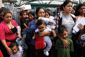 Migrants from Central America arriving at a bus station following their release from detention in Texas on Friday, two days after President Donald Trump signed an executive order that stops the practice of separating families seeking asylum. Once the