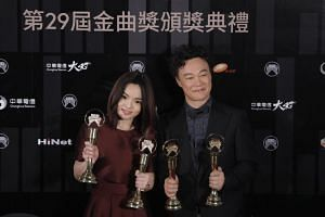 Taiwanese singer Lala Hsu Chia-ying (left) and Hong Kong singer Eason Chan (right) pose with their respective trophies after winning The Best Female and Male Vocalist Mandarin during the 29th Golden Melody Awards Ceremony at The Taipei Arena in Taiwa