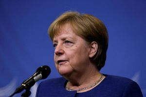 Germany's Chancellor Angela Merkel addresses media representatives after an informal summit at the EU Commission in Brussels on June 24, 2018.