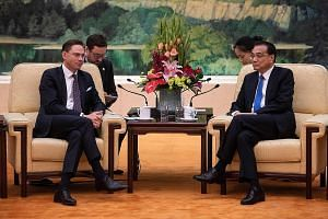 European Commission vice-president Jyrki Katainen (left) and Chinese Premier Li Keqiang in Beijing yesterday. Despite being on the same page about upholding the multilateral trading system, both sides disagreed over creating a level playing field for