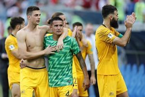 Players of Australia react after the FIFA World Cup 2018 group C preliminary round soccer match between Australia and Peru in Sochi, Russia, on June 26, 2018.