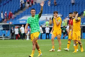 Australia's Tim Cahill waves to fans at the end of the match.