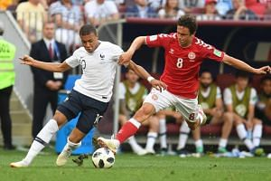 France's forward Kylian Mbappe (left) vies with Denmark's midfielder Thomas Delaney during the Russia 2018 World Cup Group C football match between Denmark and France at the Luzhniki Stadium in Moscow on June 26, 2018.
