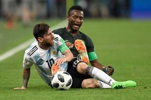Argentina's Lionel Messi competes for the ball in his country's crunch World Cup match against Nigeria.
