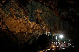 Journalists working in Tham Luang cave during a search for members of an under-16 soccer team and their coach, in the northern province of Chiang Rai, Thailand, on June 27, 2018.