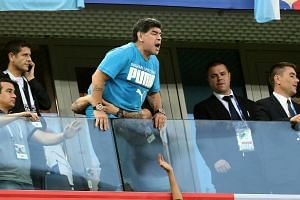 Argentina legend Diego Maradona watches his country's match against Nigeria in the stands.