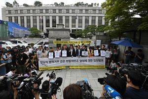 South Korean activists and conscientious objectors to military service during a rally outside the Constitutional Court in Seoul, on June 28, 2018.