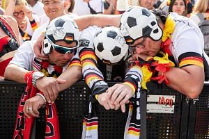 German fans watch their national team losing the Fifa World Cup 2018 match against South Korea at the public viewing area in front of the Brandenburg Gate in Berlin, Germany, on June 27, 2018.