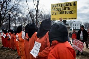 Activists protest the Guantanamo Bay detention camp during a rally in Lafayette Square outside the White House in Washington, DC, on Jan 11, 2018.