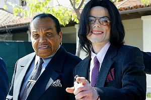 The late singer Michael Jackson (right) with his father, Joe Jackson, at the Santa Maria Superior Court during the second week of Michael's child molestation trial in Santa Maria, California, in 2005.
